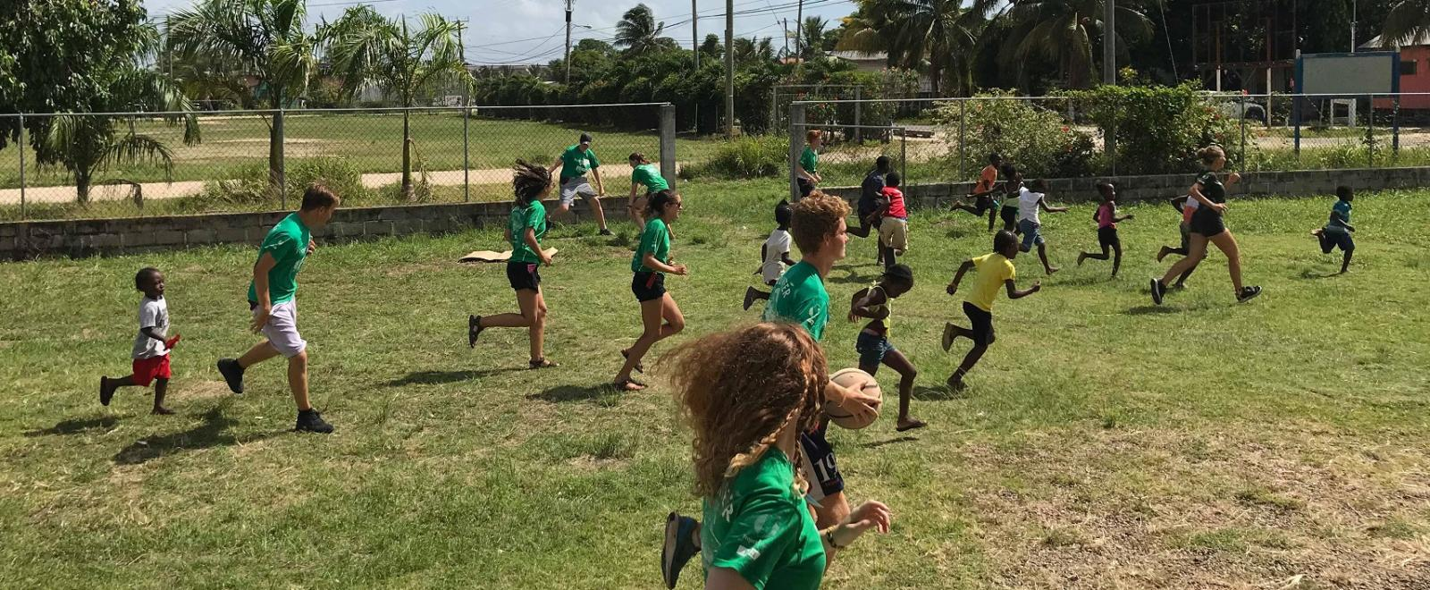 Projects Abroad Sports Coaching volunteers play games with schoolchildren in Belize